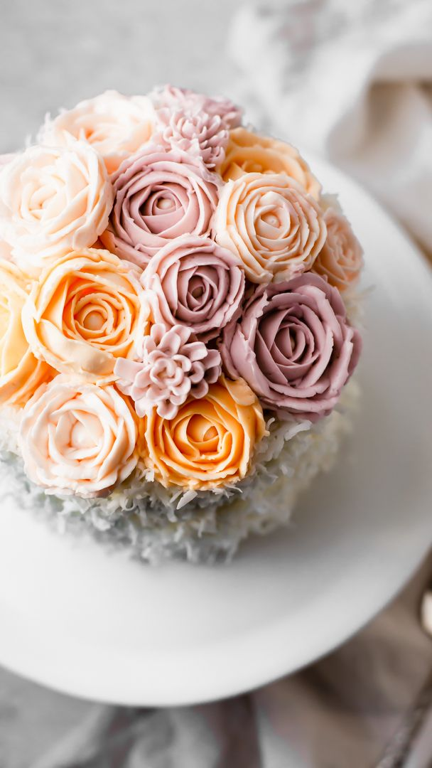 Raspberry Jam Filled Coconut Cake with Buttercream Flowers