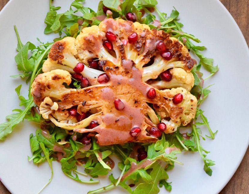 Cauliflower Steaks with Pomegranate Sauce and Arugula Salad