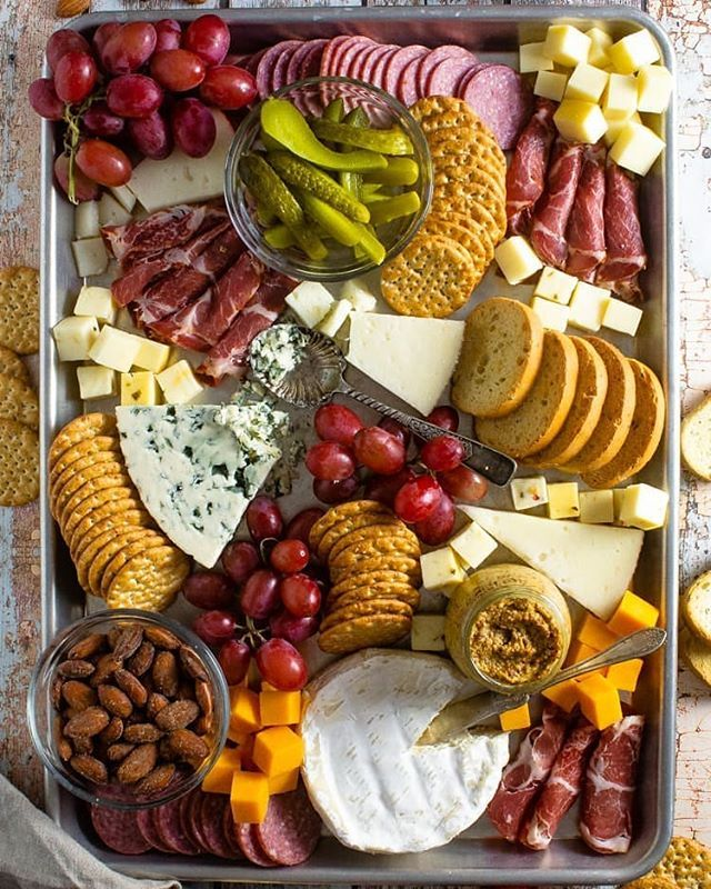 Charcuterie and Cheese Board with Cornichons and Nuts