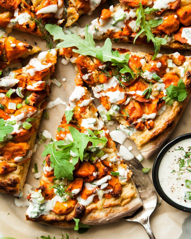 Buffalo Cauliflower Pizza with Creamy Roasted Onion Drizzle