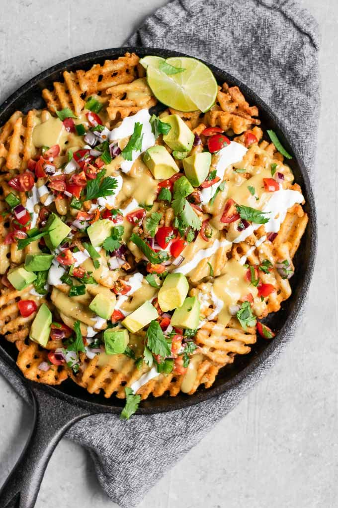 Waffle Fry Nachos with Spicy Creamy Coconut Drizzle