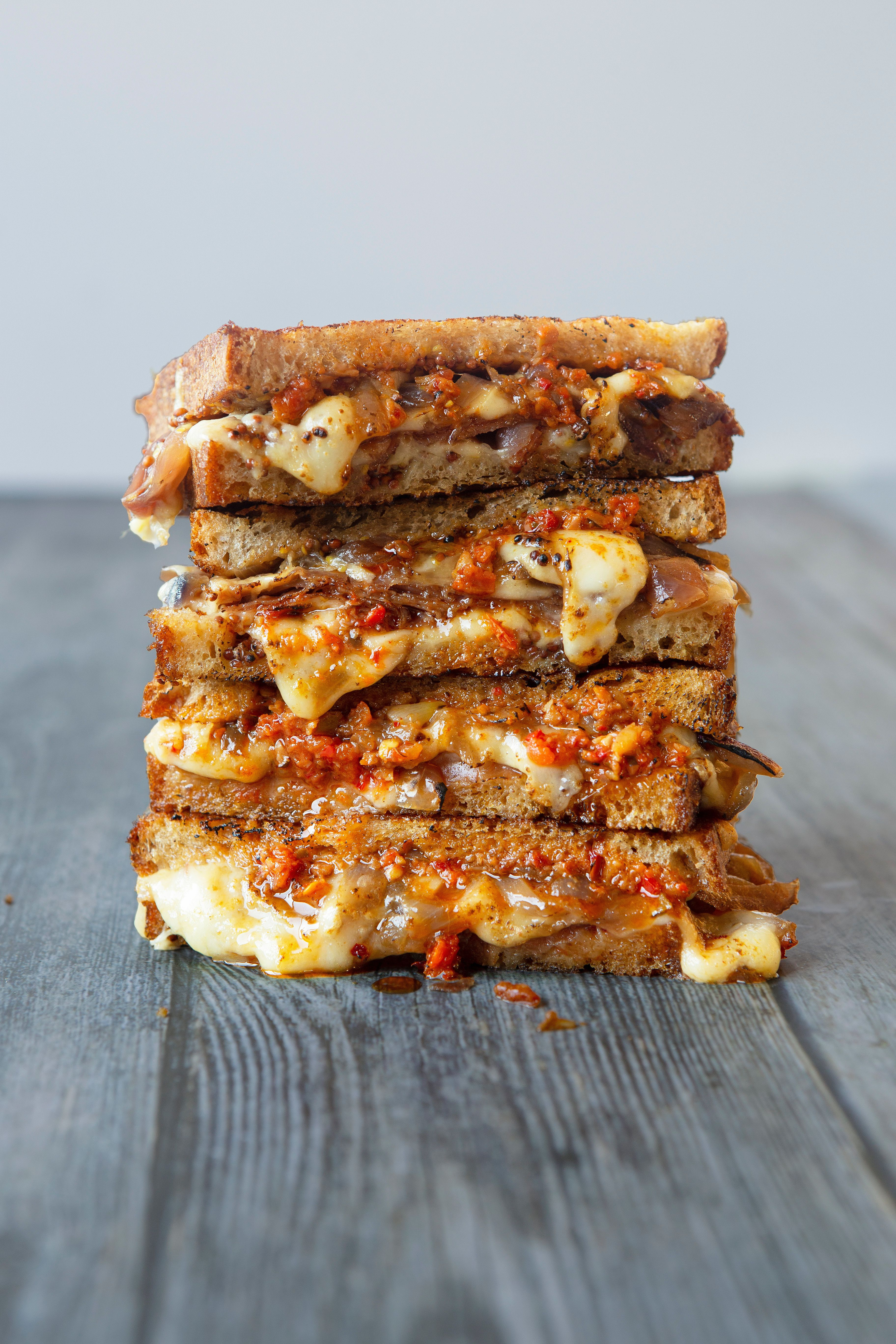 Grilled Cheese with Gruyere, Prosciutto, Caramelized Onions, Honey and Hot Pepper Spread