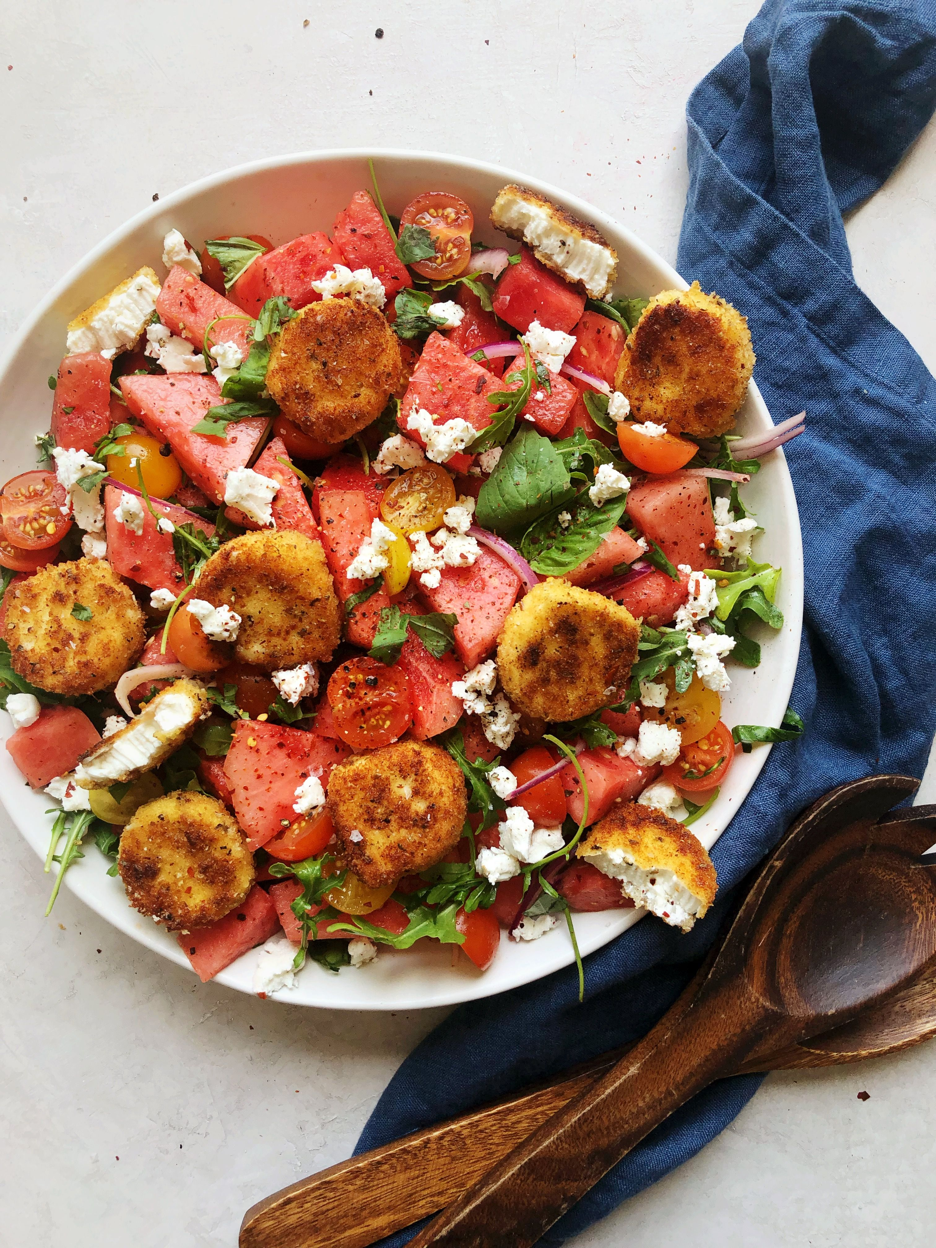 Watermelon and Cherry Tomato Salad with Fried Goat Cheese Medallions