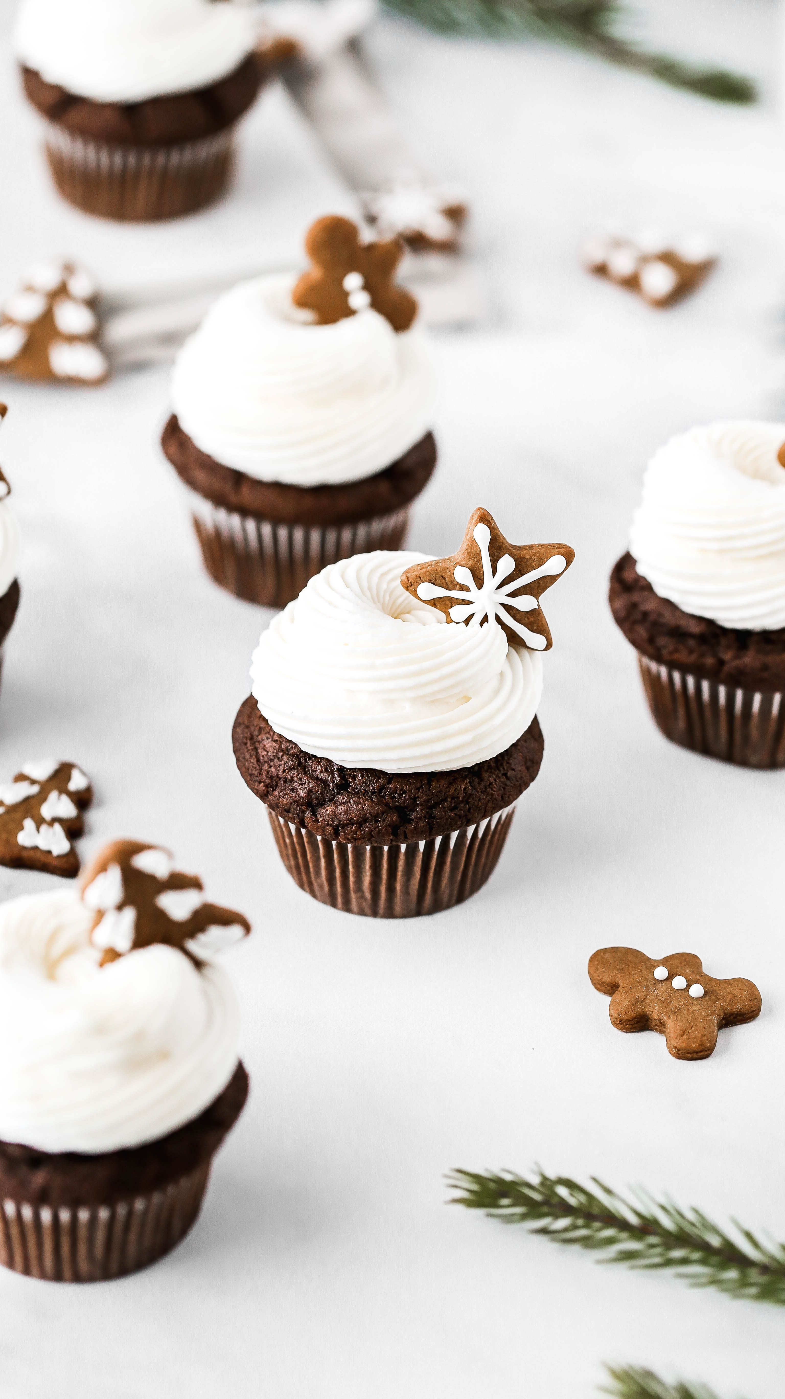 Frosted Gingerbread Cupcakes with Gingerbread Cookie Topper