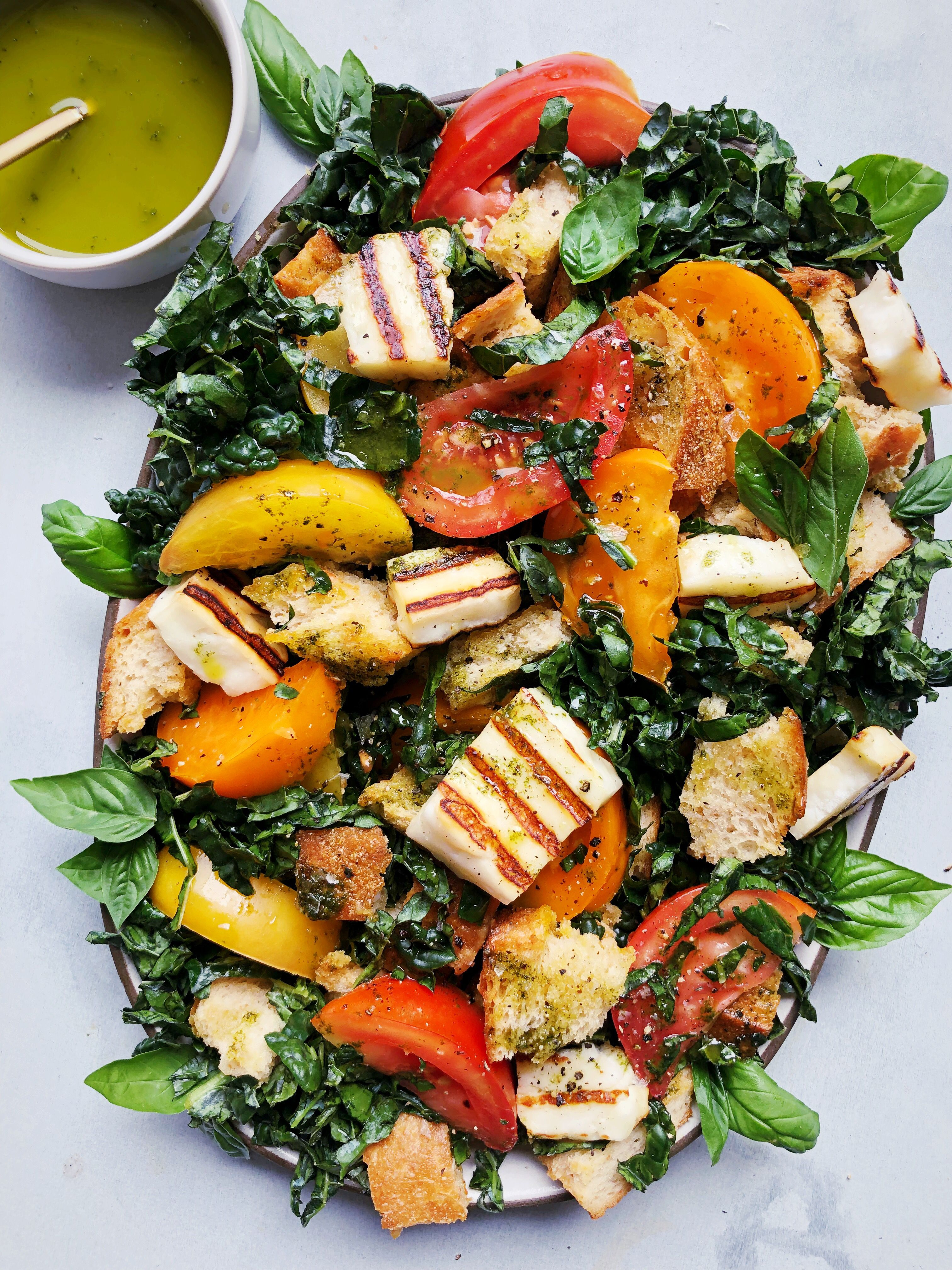 Heirloom Tomato and Grilled Halloumi Panzanella with Basil Oil