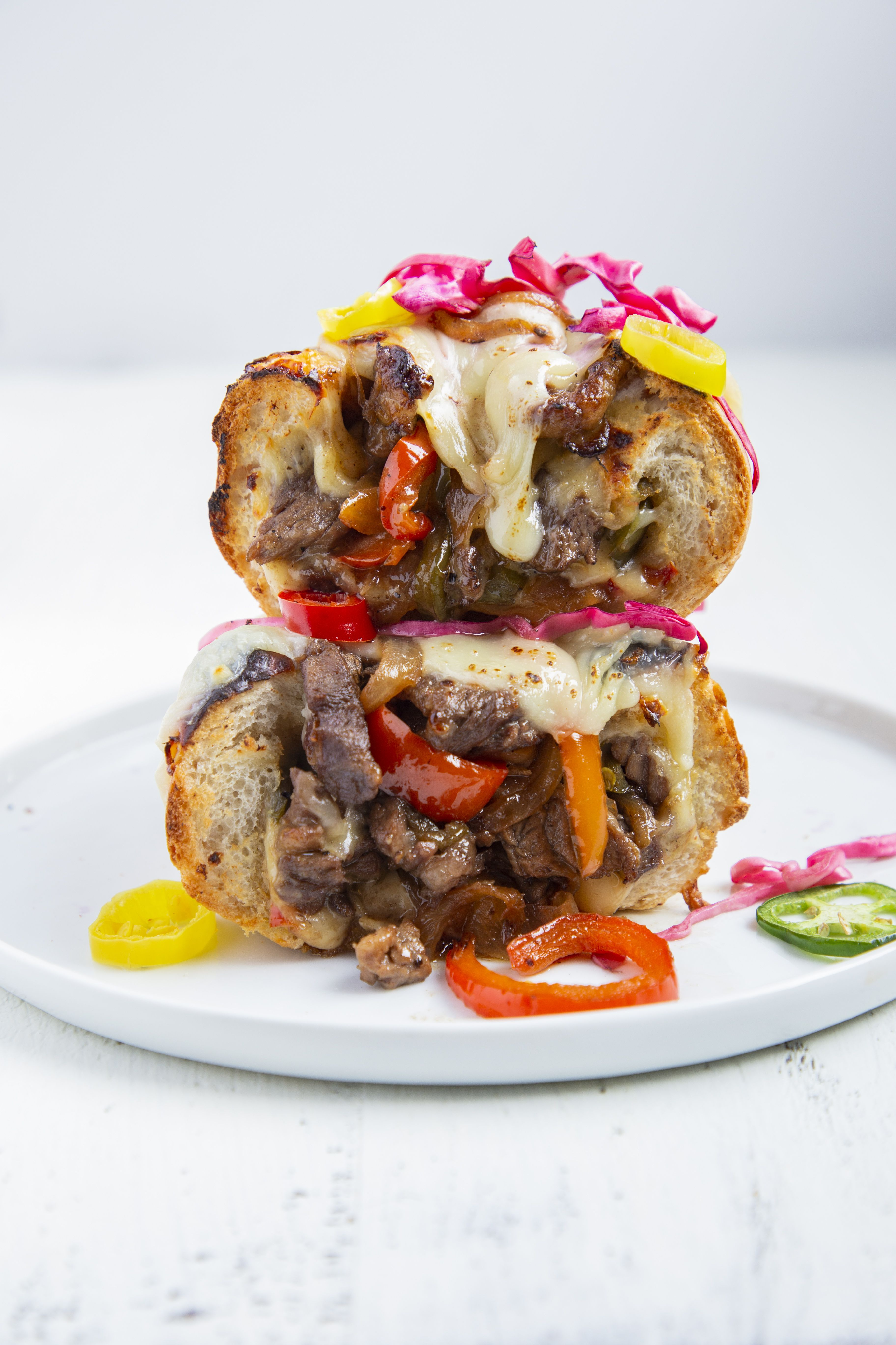 Philly Cheesesteaks with Peppers, Onions and Pickled Vegetables