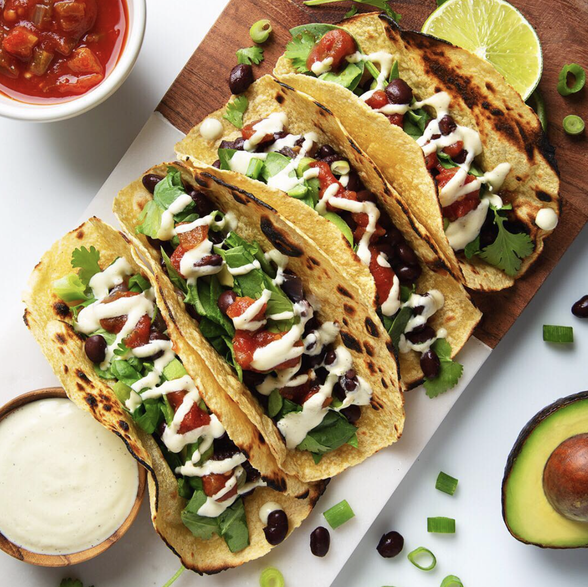 Black Bean Breakfast Tacos with Creamy Garlic Sauce