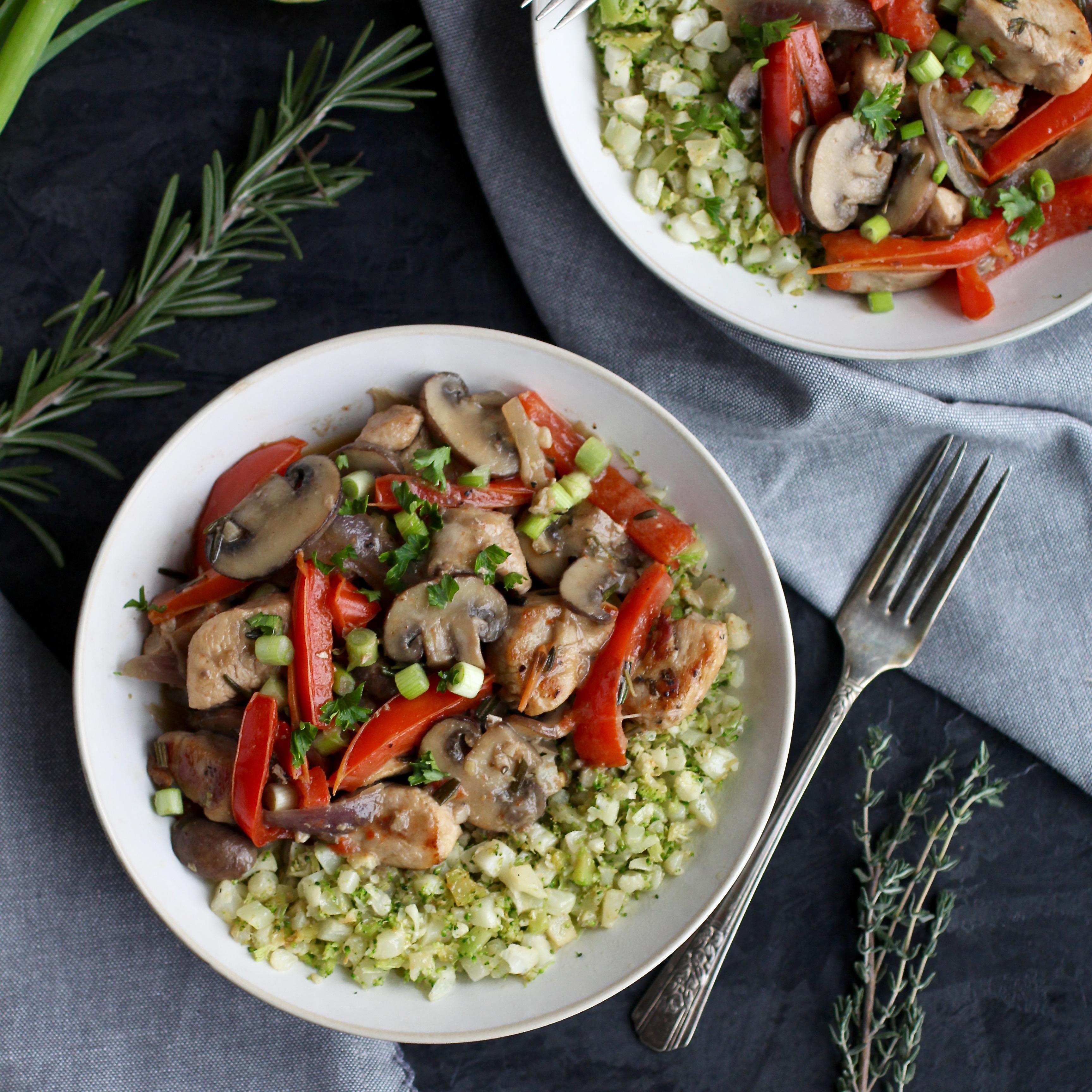 Herbed Garlic Chicken Skillet Served Over Cauliflower And Broccoli Riced Veggies